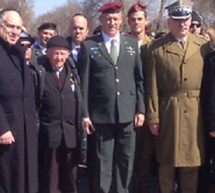 Vladimir Sloutsker, IJC President & Co-Founder, lights torch at Auschwitz-Birkenau during March of the Living ceremony